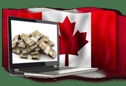 ordinateur avec billets CAD et drapeau Canada
